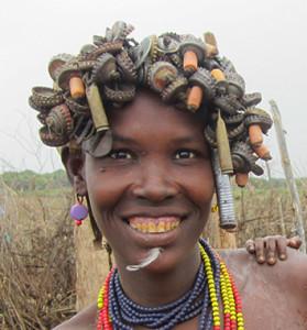 Desenech woman with bottle cap head adornment